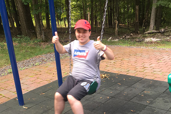 Camper on Swing