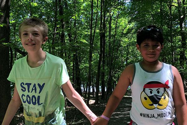 Kids 1 Campers holding hands