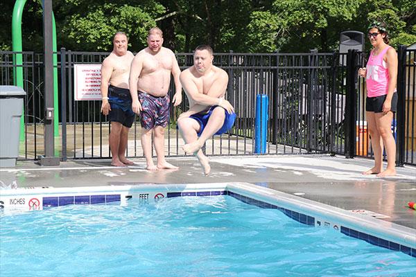 campers diving in pool
