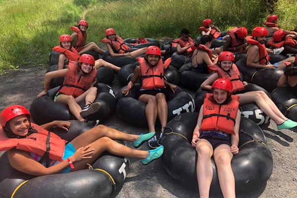 campers going tubing