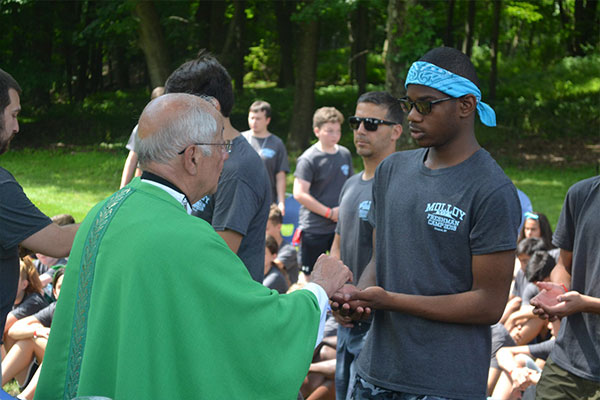 campers receiving communion