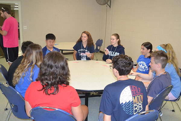 campers at meeting table