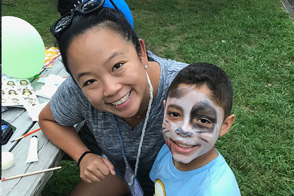 face painting with camper and counselor