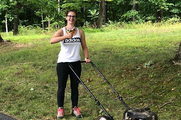 MBCE volunteer mowing lawn