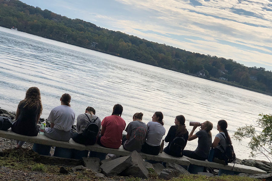 Retreats group by a river